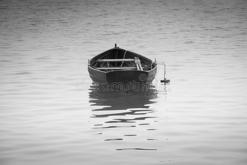Black and white rowing boat with reflection stock photos