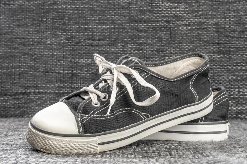 Old well preserved shoes on the textile background royalty free stock photography