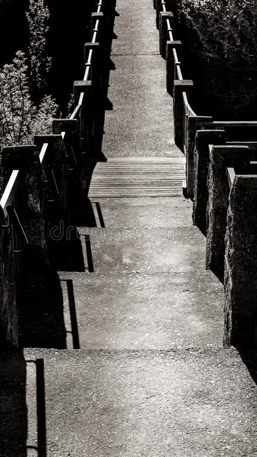 Path on bridge black and white stock photography