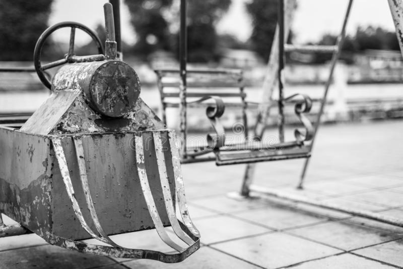 Black and white Selective focus of Old toys in the playground stock photo