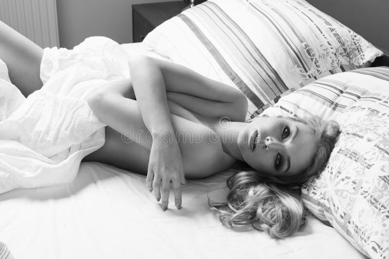 naked girl on black sheets