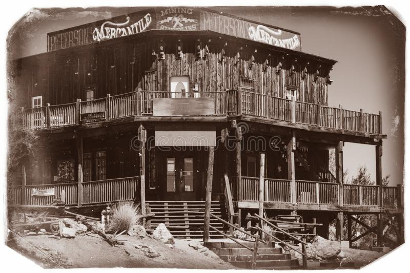 Black and White Sepia Vintage Photo of Old Western Wooden Building/Saloon in Goldfield Gold Mine Ghost Town. In Youngsberg, Arizona, USA surrounded by cactuses royalty free stock image