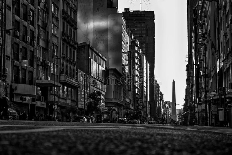 A black and white shot of Corrientes Ave. Buenos Aires. Taken in Buenos Aires, the Obelisco in the background stock image