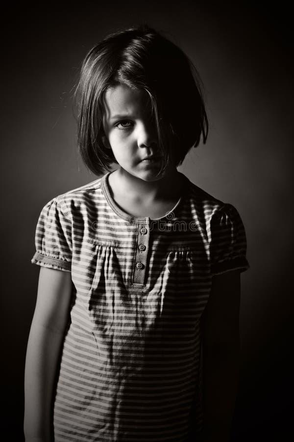 Black and White Shot of a Sad Child. Low Key Black and White Shot of a Sad Child stock photo