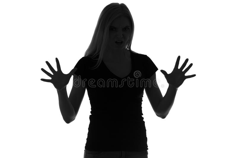 Black and white silhouette of frightened woman royalty free stock photos
