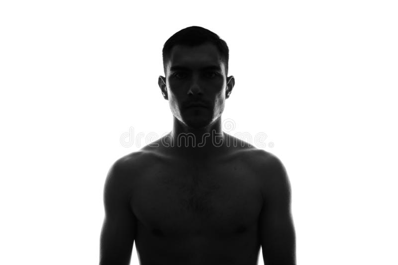 black and white Silhouette Portrait of young man with naked torso stock images