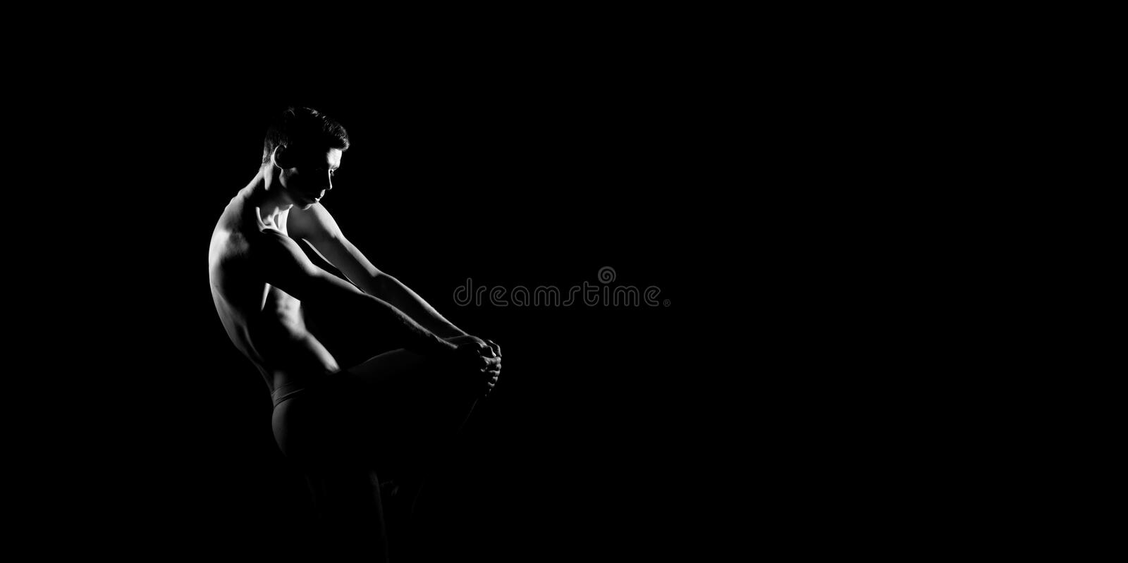 Black and white silhouette of male ballet dancer. Long monochrom horizontal image. stock images