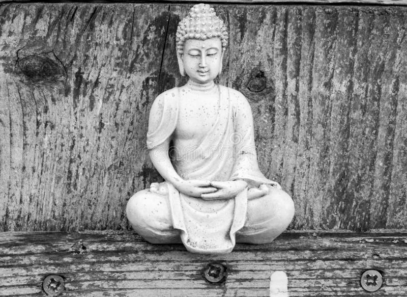 Black and white, sitting, little Buddha figure royalty free stock photography