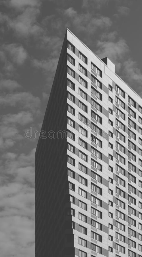 Black and White Skyscraper on the Sky Background. Black and White Skyscraper on the Cloudy Sky Background stock photo