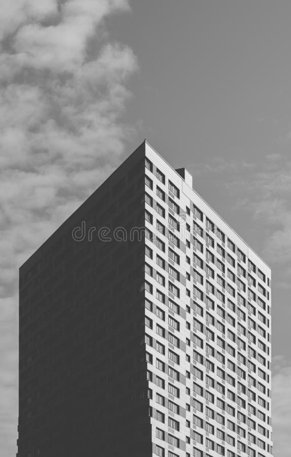Black and White Skyscraper on the Sky Background. Black and White Skyscraper on the Cloudy Sky Background stock images
