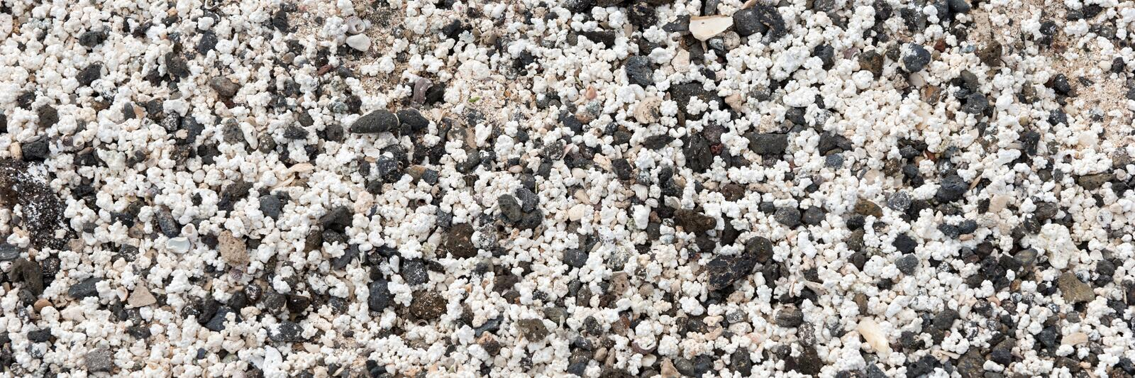 Black and white small pebbles stock photography