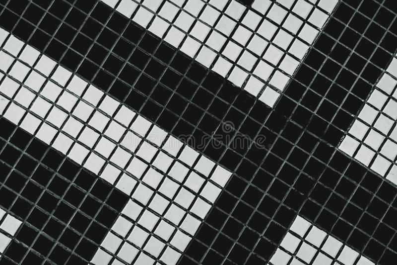 Black and white small square bathroom floor tile with modern pattern. Top view of bathroom wall tile. Small square tile abstract royalty free illustration