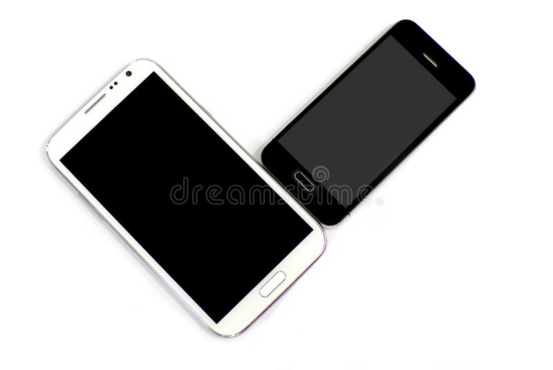 Black and white smart phones. In composition stock images