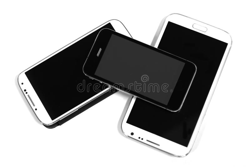 Black and white smart phones. In composition stock photo