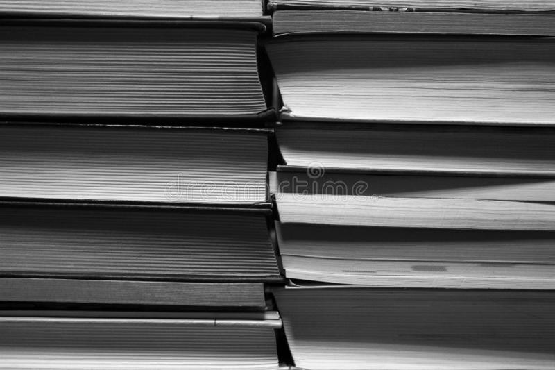 Black and white stack of books background stock photo