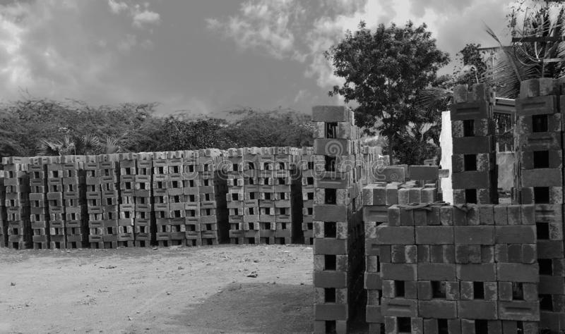Black and white - Stacks of concrete blocks stock images