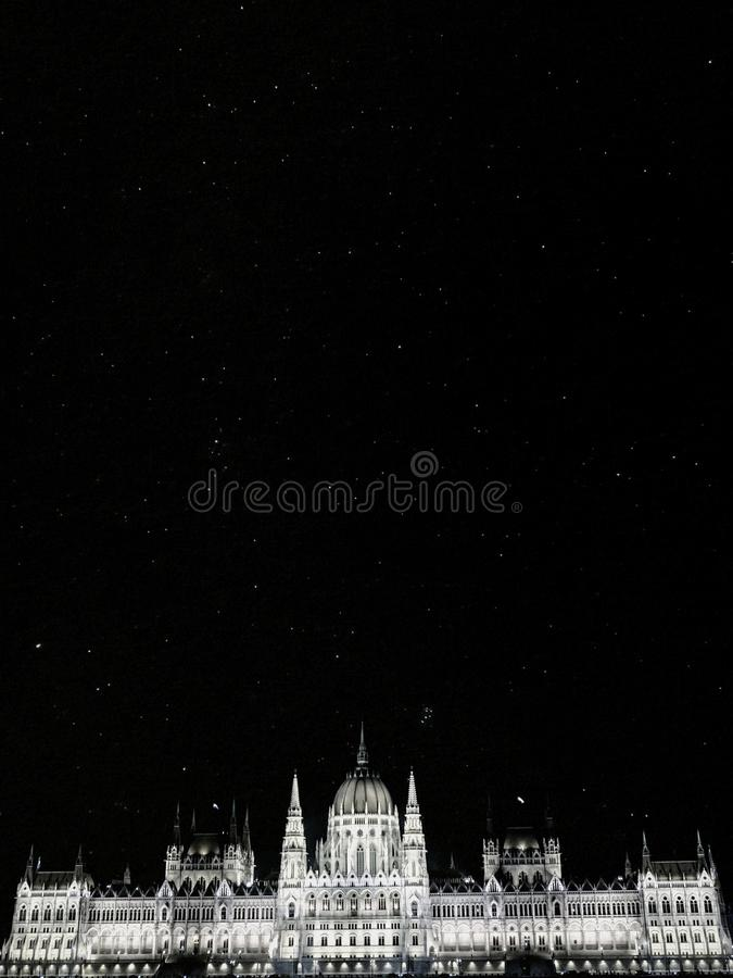Black and white starry night above Hungarian Parliament building in Budapest stock photography