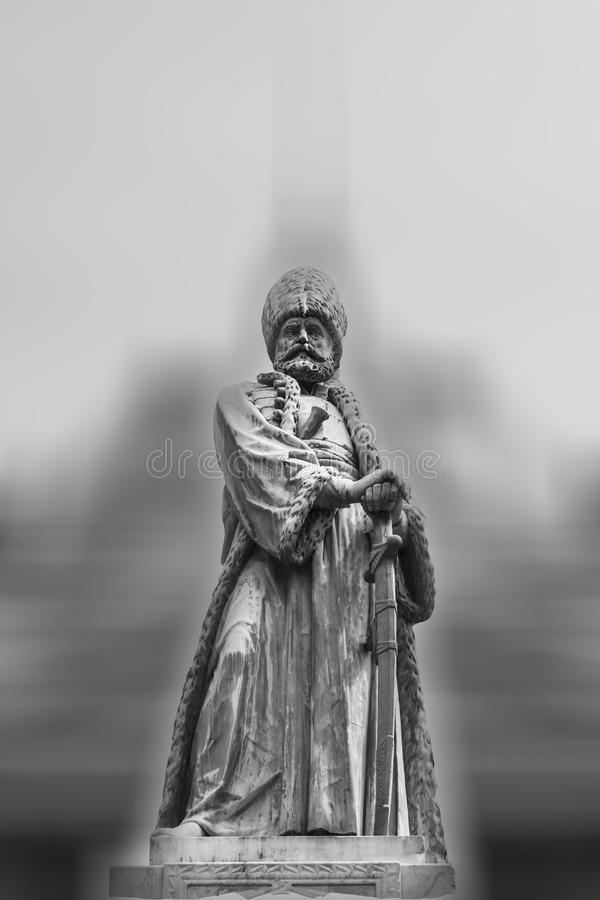 Black and white statue of a king or feudal lord. With blurred background royalty free stock photos