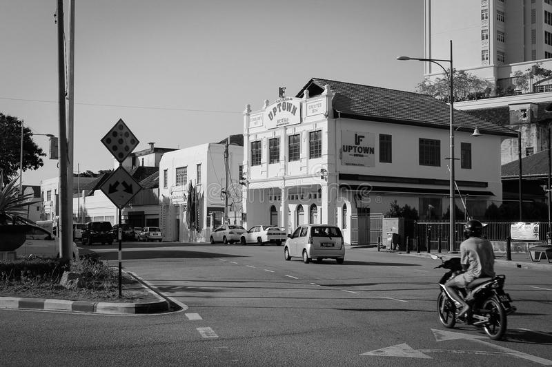 Black and white street photo of motorcyclist in Penang stock image