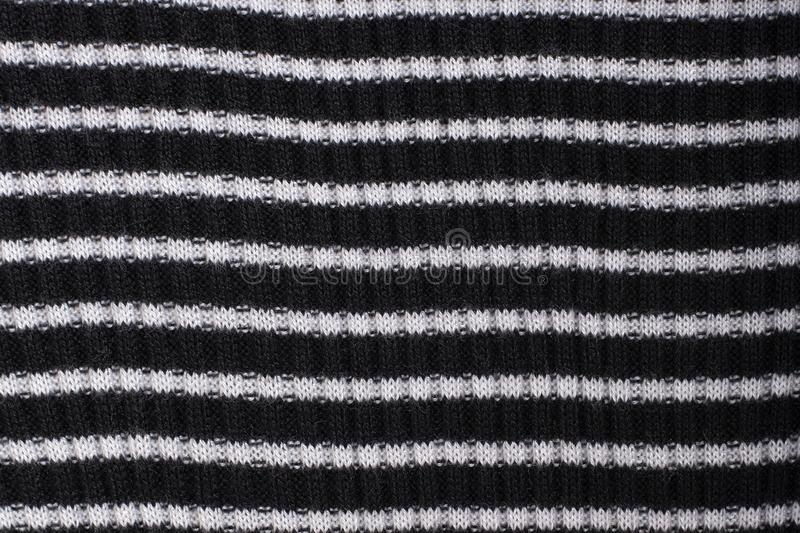 Black and white striped knitted fabric. Close up. Fashionable co. Ncept stock photography