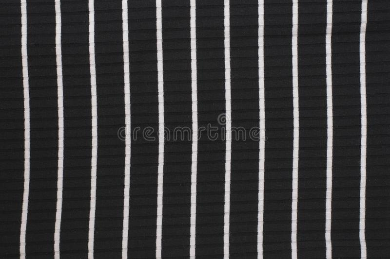 Black and white striped knitted fabric. Close up. Fashionable co. Ncept stock photo