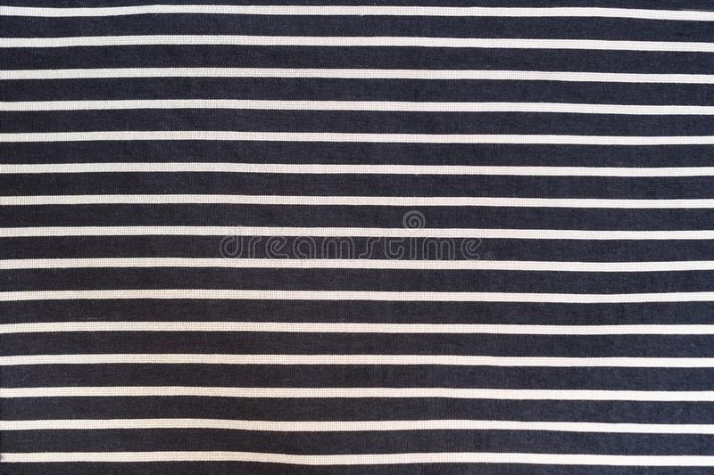 Black with white stripes seamless fabric. Textural background.  stock image