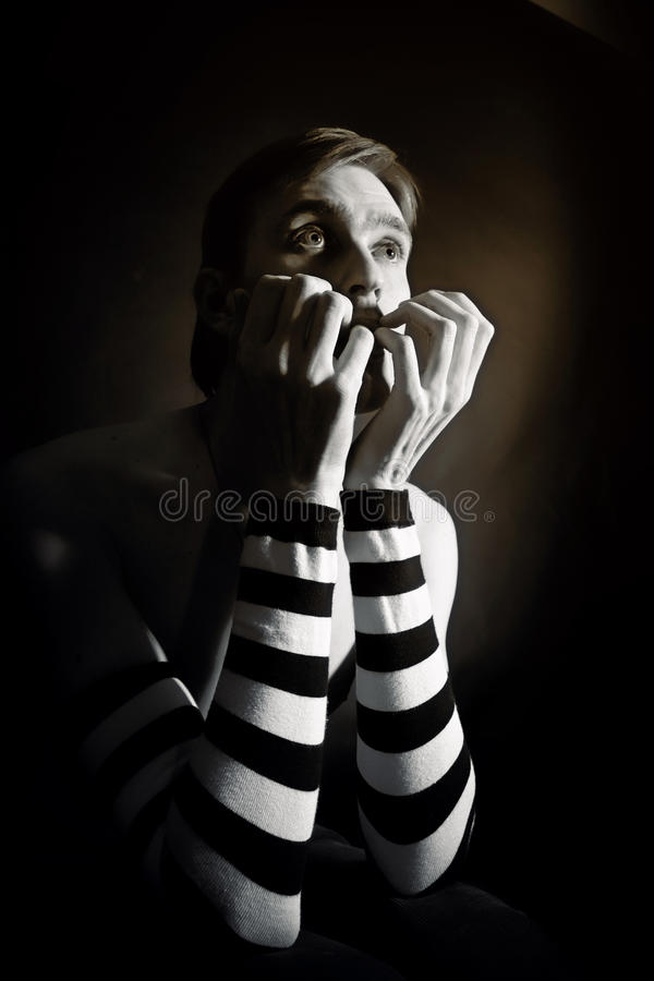Black and white studio portrait of a young man in striped sleeve stock images