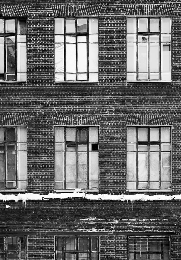 Black and white stylization of the old facade of the building stock photos
