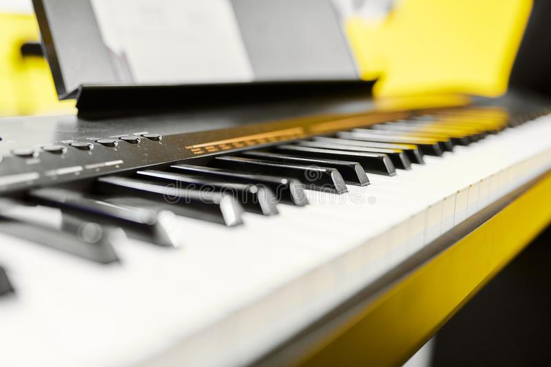 Black and white synth keys on yellow background royalty free stock images