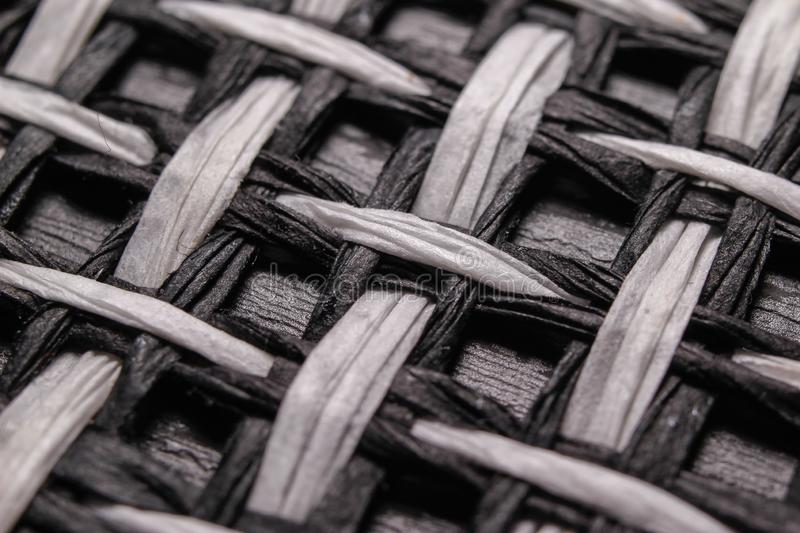 Black and white textile pattern background. Macro close-up photography stock image