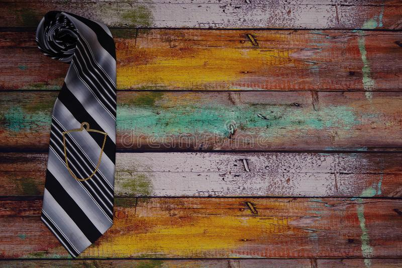 Tie on Wooden floor with Tie Chain royalty free stock photo