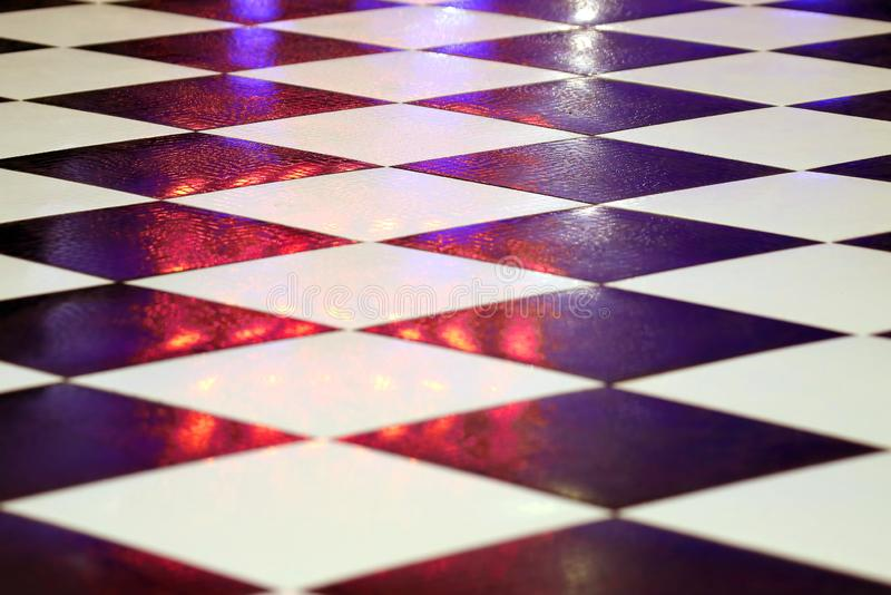 Black and white tiles on the floor stock image