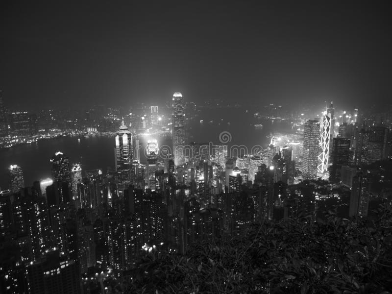 Black and white tone Hong Kong the scenes, victoria harbour from the peak bird view, in the mist with bad weather in the night,. Nimbus landscape on the trails stock photos