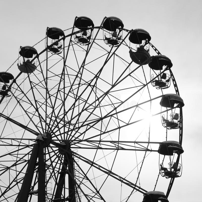 Black and white toned image with an old ferris wheel against sky. Black and white toned image with an old ferris wheel against the sky royalty free stock photos