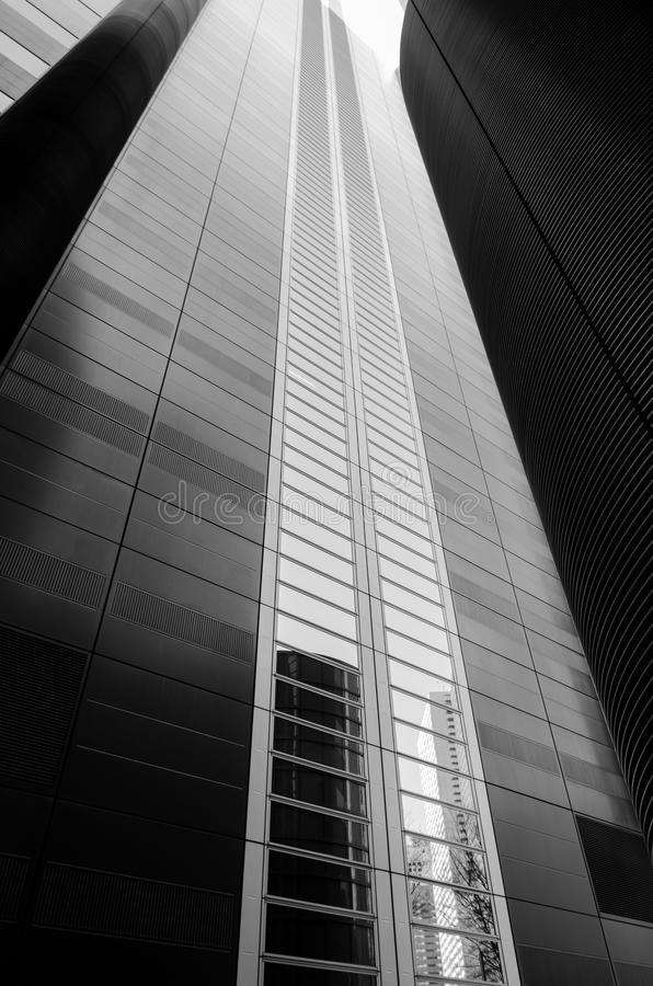 Black and white towering skyscraper. A modern, contemporary towering skyscraper in Tokyo Japan. Black and white photograph royalty free stock photography