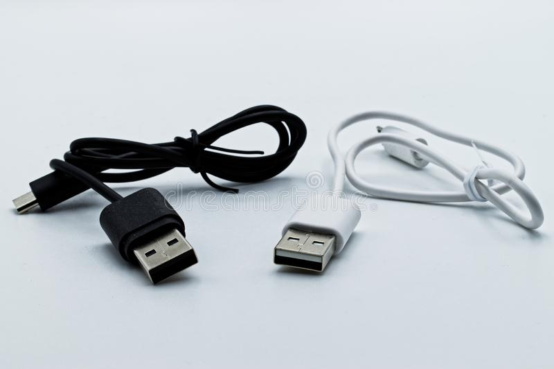 Black and white usb plugs  on a white background stock image