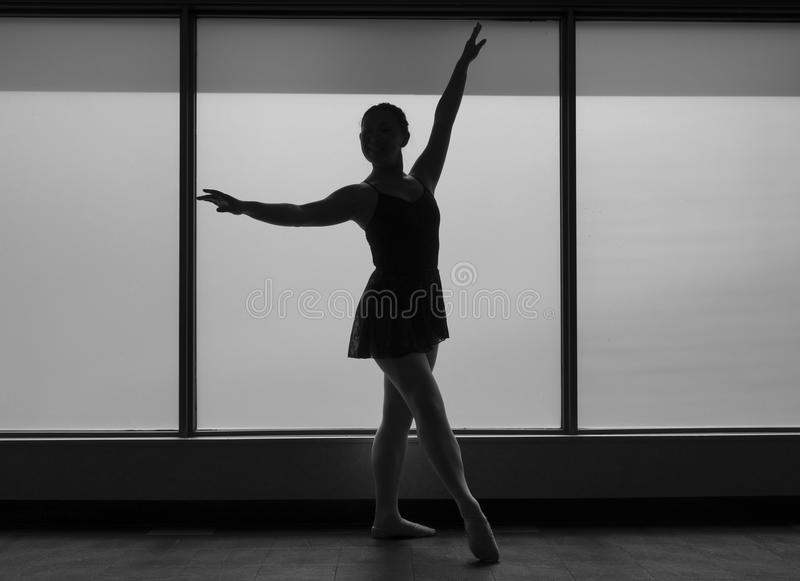 Black and White version of Ballet dancer Silhouette in a Window frame royalty free stock photo