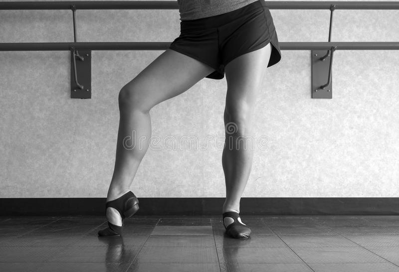Black and White version of Posing in Jazz shoes at the barre in dance class stock photo