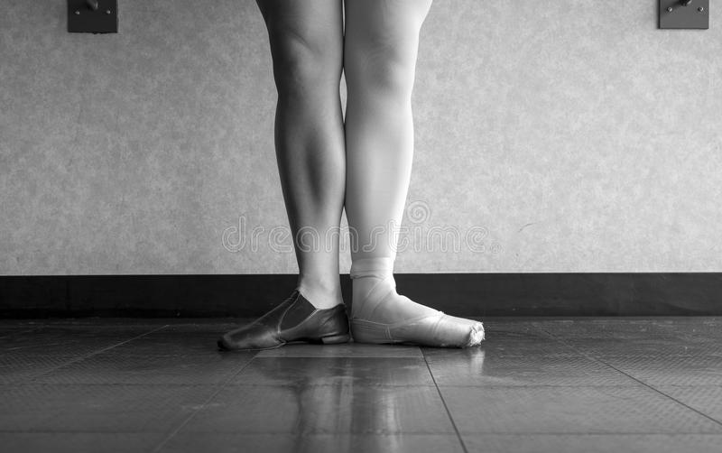 Black and White version of Two sides to a dancer- the Ballerina and the jazz dancer stock photo