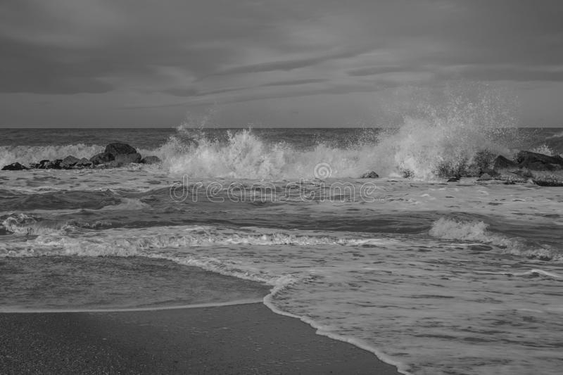 Black and white view of Adriatic sea during winter stormy stock images
