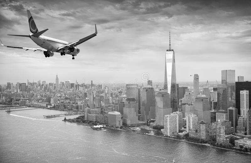 Black and white view of airplane over New York City. Tourism con royalty free stock images