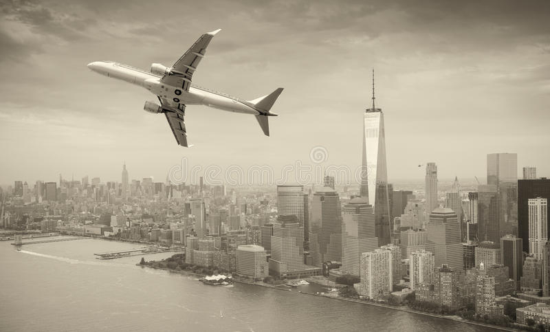 Black and white view of airplane over New York City. Tourism con stock photography