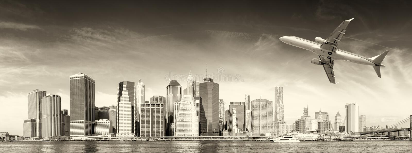 Black and white view of airplane over New York City. Tourism con royalty free stock image