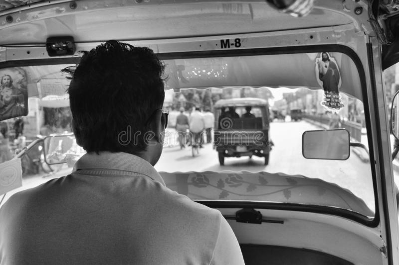 View from the inside of an auto-rickshaw in West Bengal, India. Black and white View from the inside of an auto-rickshaw in West Bengal, India stock images