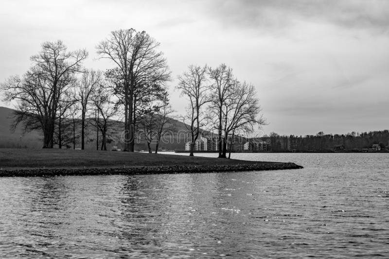 Black and White Image of Smith Mountain Lake, Virginia, USA. A black and white view of Smith Mountain Lake with condominiums and Smith Mountain in the background stock images