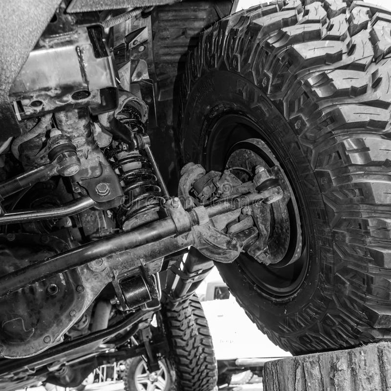 Black and white view from under a car. Close-up view of a car's stock image