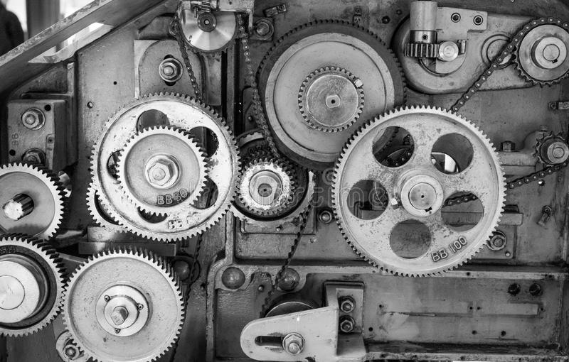 Black and White Vintage Gears. A monochrome image of gears inside of a vintage textile machine used to spin wool products stock photography