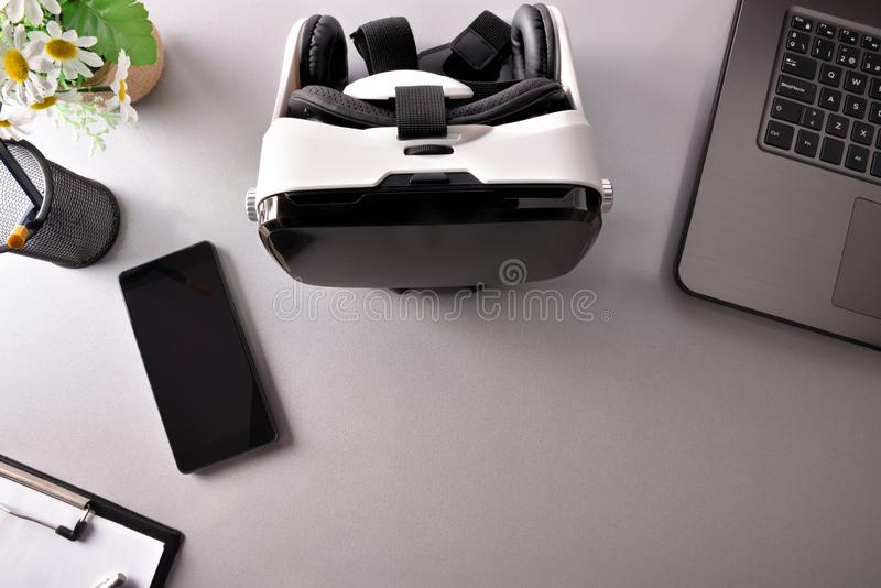 Virtual reality glasses on business office table top view closeup royalty free stock image
