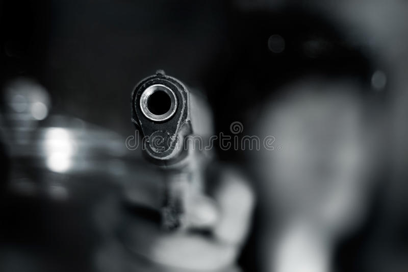 Black and white, woman pointing a old gun to front with one Hand stock images