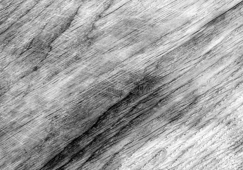 Black and white wooden board surface wuth scratches. stock photo
